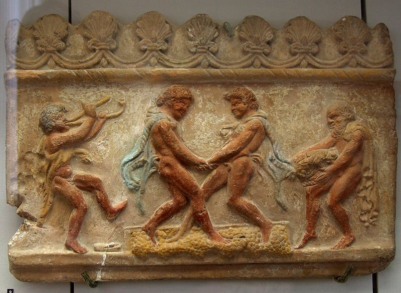 Roman architectural relief depicting wine treading: